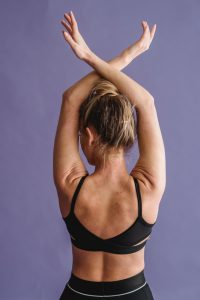 Woman stretching her back to correct posture